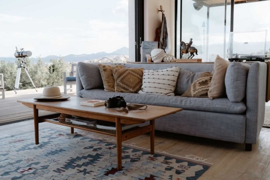 large sofa in front of glass wall