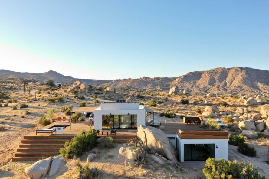 tiny retreat in the middle of a desert landscape