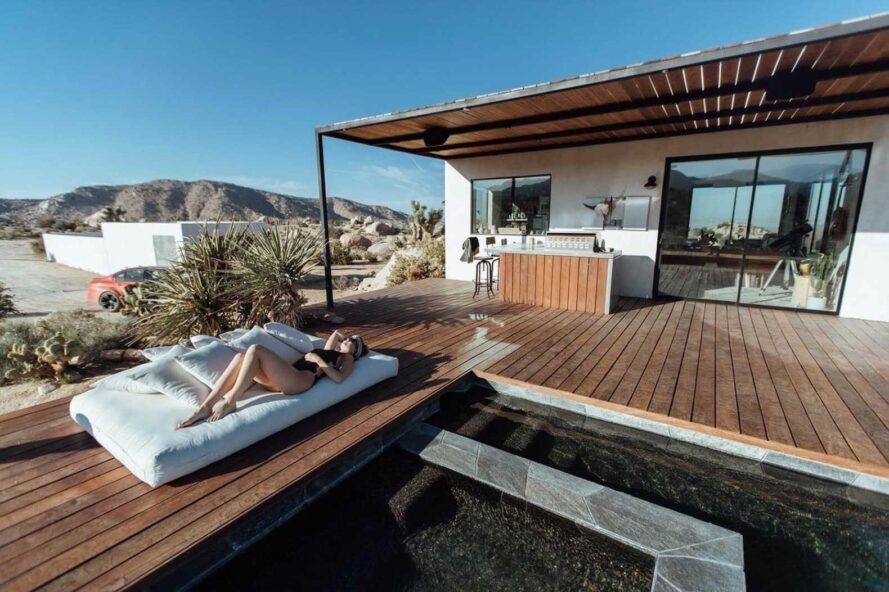 outdoor deck with pool and jacuzzi