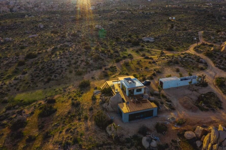 aerial shot of structure in middle of desert