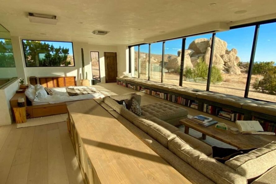 large living space with glass facade