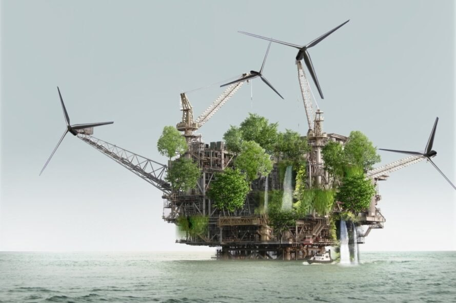 oil platform covered in greenery with windmills