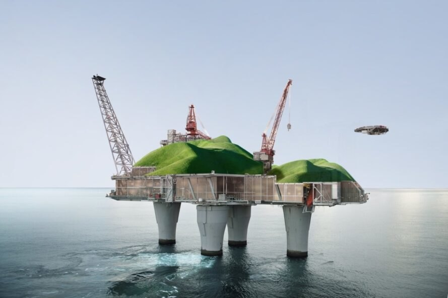 offshore oil platform with green hilly landscape on top