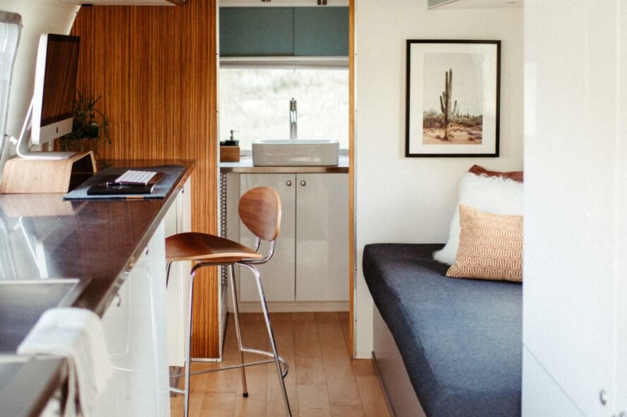 bench seating and a countertop inside an airstream trailer