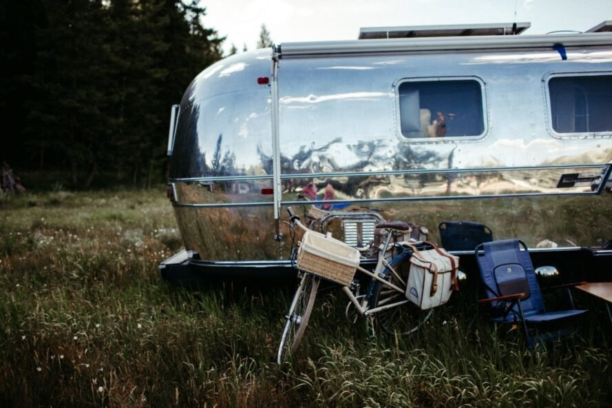 back view of airstream trailer with a bike next to it