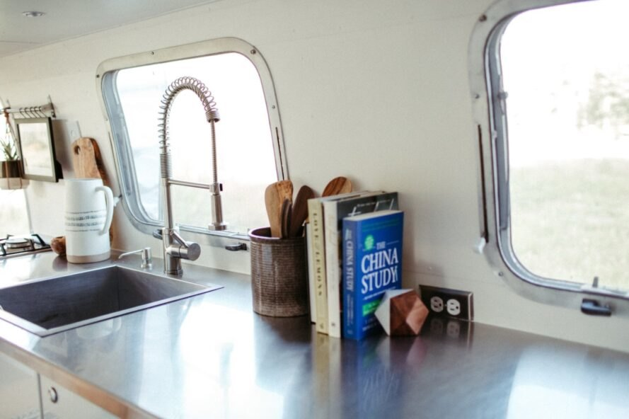 kitchen countertop with sink and cook books