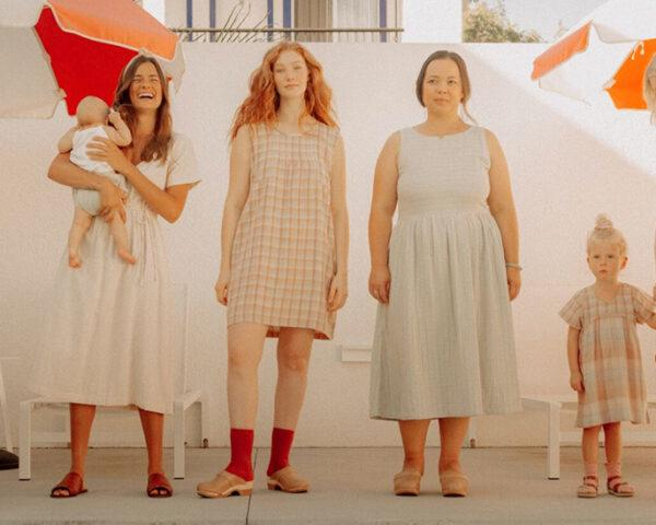 group of friends and their children all wearing organic cotton dresses