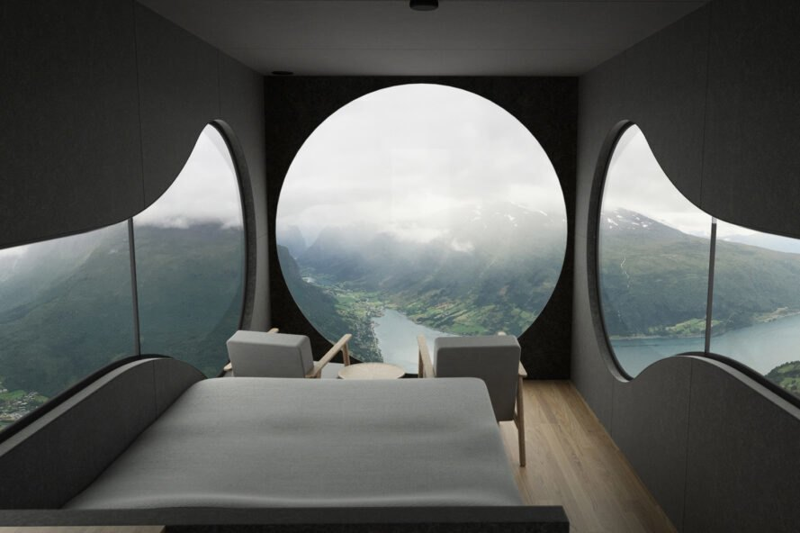 bed in small room with round windows
