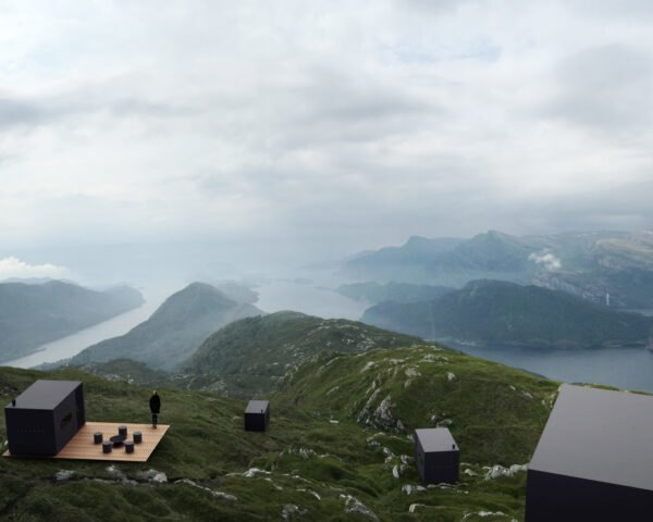 black cabins on a mountainous landscape