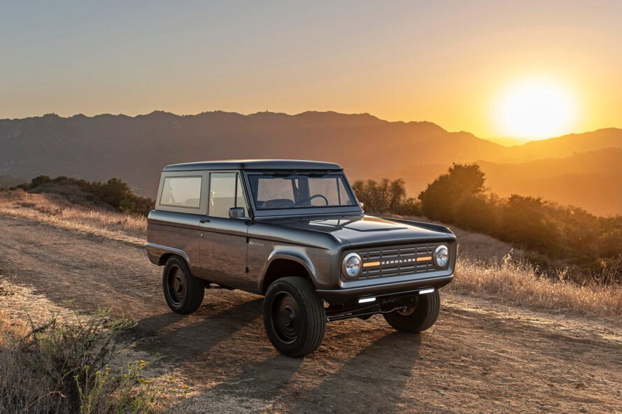 Ford Bronco on dirt road at sunset