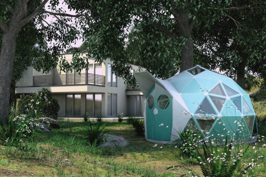 Rendering of the blue geodesic dome house in the backyard of a large modern house