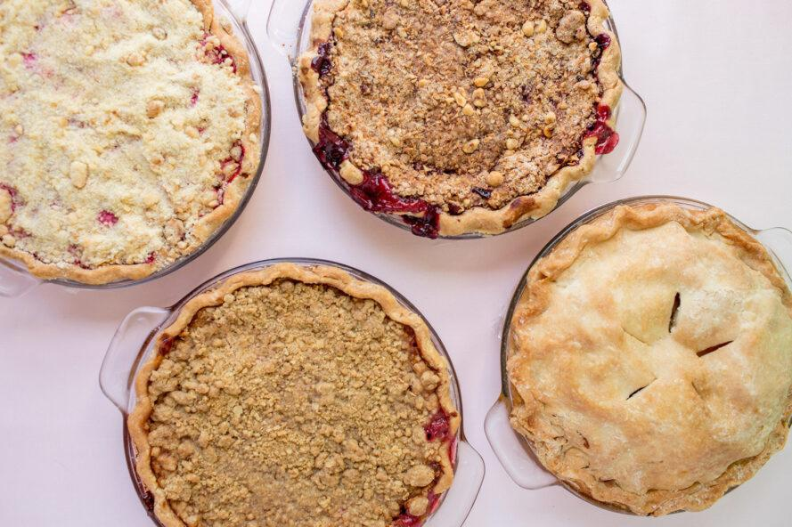 aerial view of four pies in glass dishes