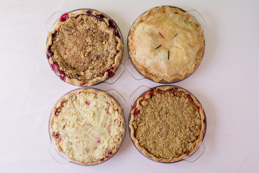 aerial view of four berry pies
