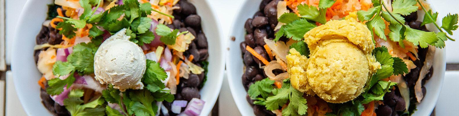 bowls of black beans and raw veggies