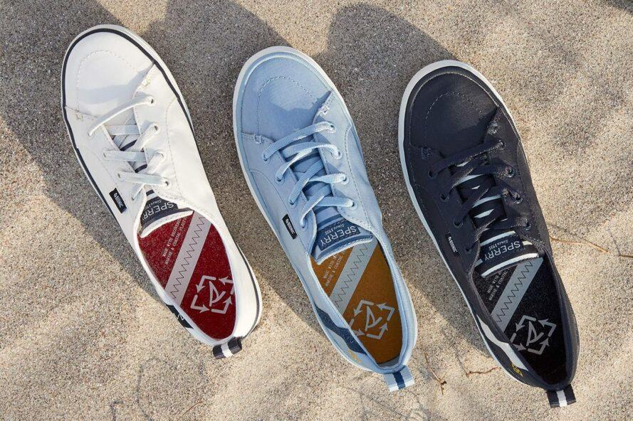 white, blue, and black boat shoes on sand
