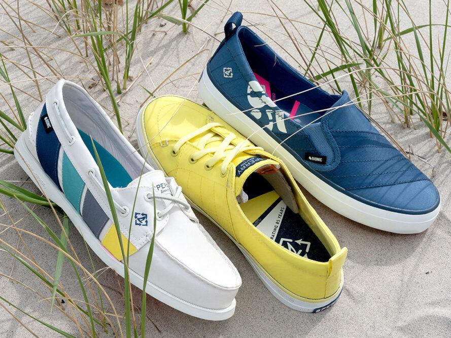 white, yellow and dark blue boat shoes on sand