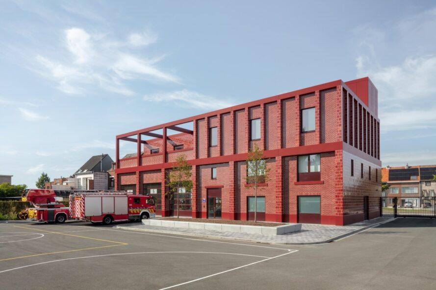 elongated red brick building with parking spaces out front