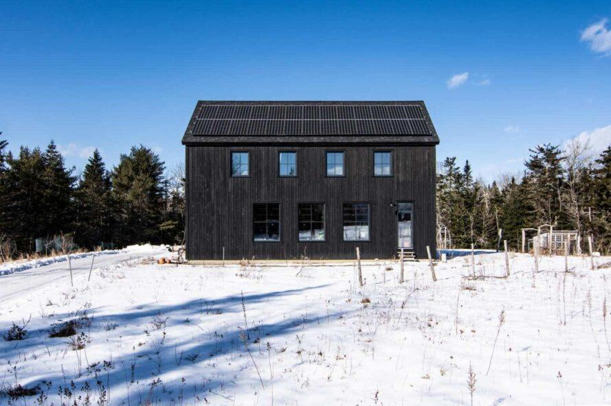 barn-like home with jet-black exterior cladding