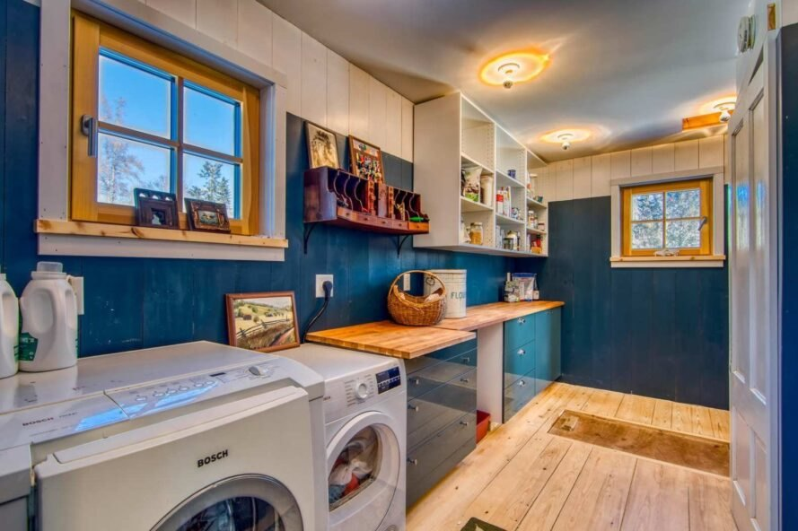 blue room with washing and drying machines