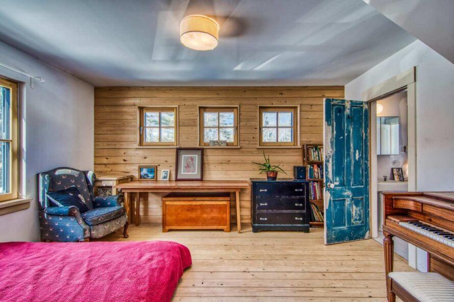 large room with wooden accent wall