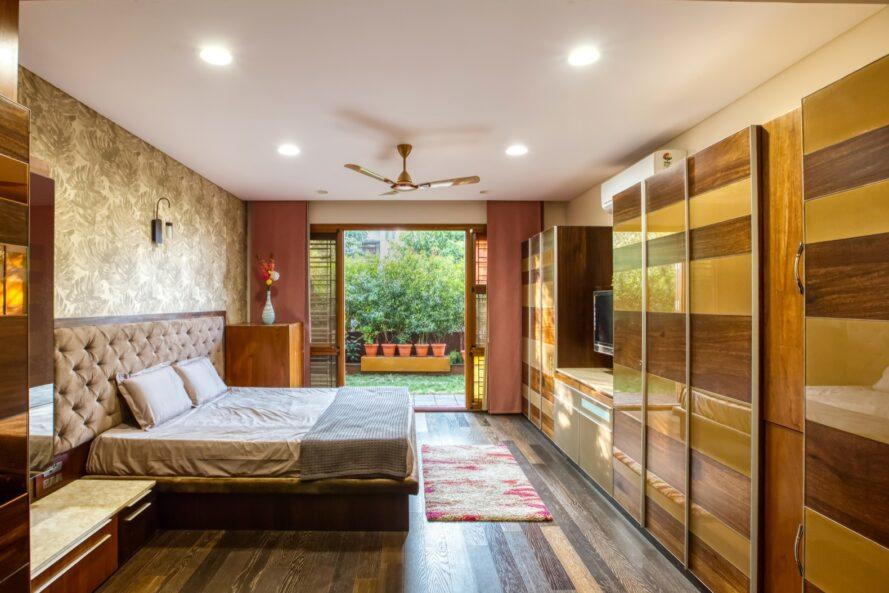 large bed near open glass doors