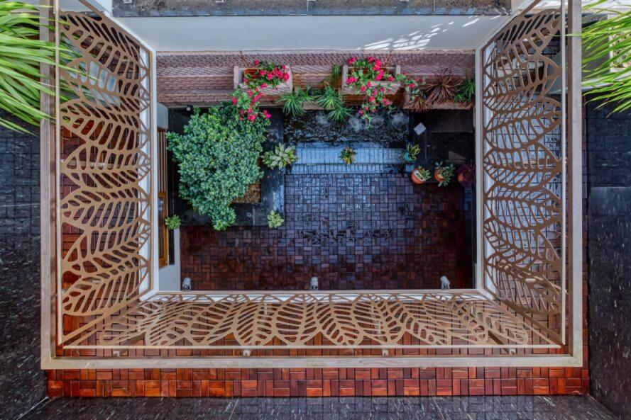 aerial view of brick courtyard filled with plants