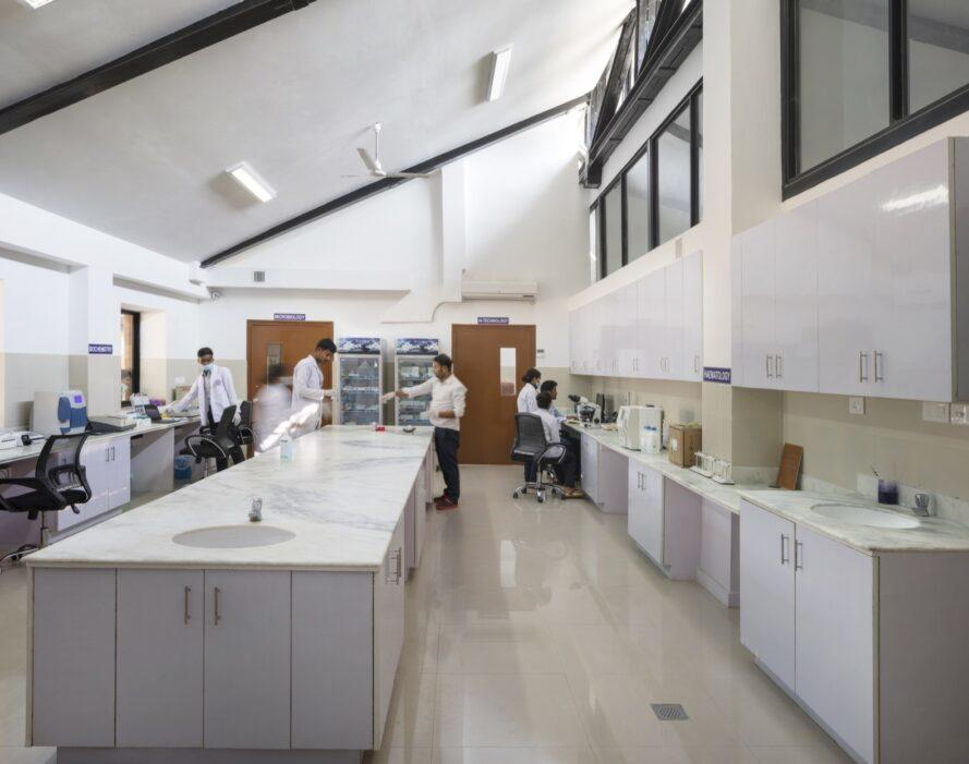 medical lab space with long island with marble countertops