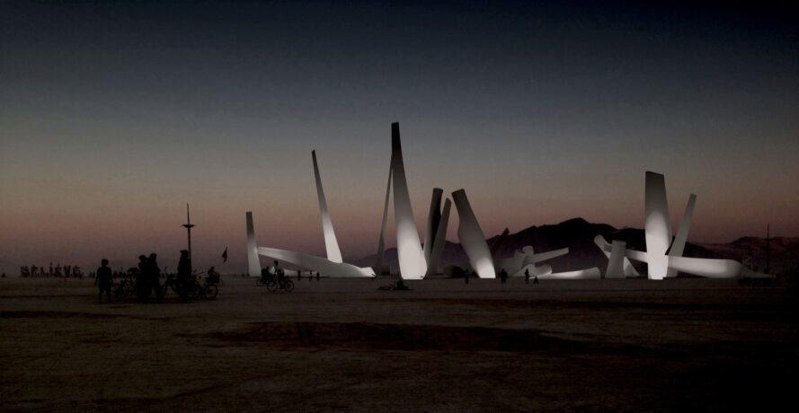 rendering of wind turbine blades in the desert lit up at night