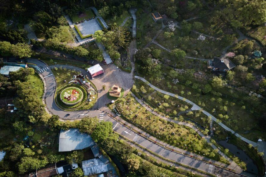 aerial shot of lush landscaped garden and walkway