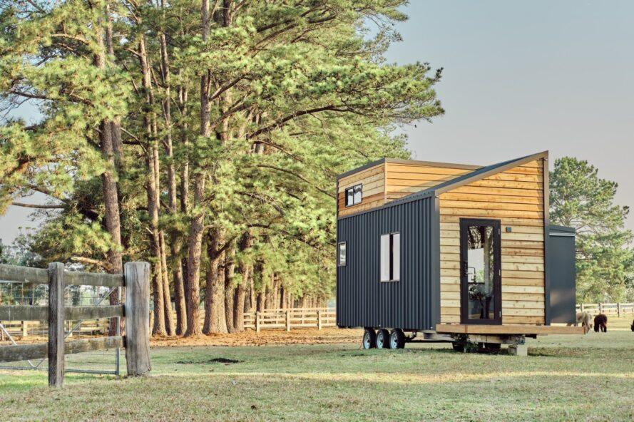 tiny home on wheels with wooden exterior