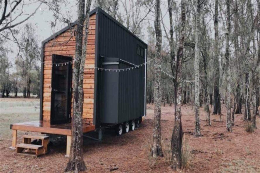 tiny home on wheels in forest