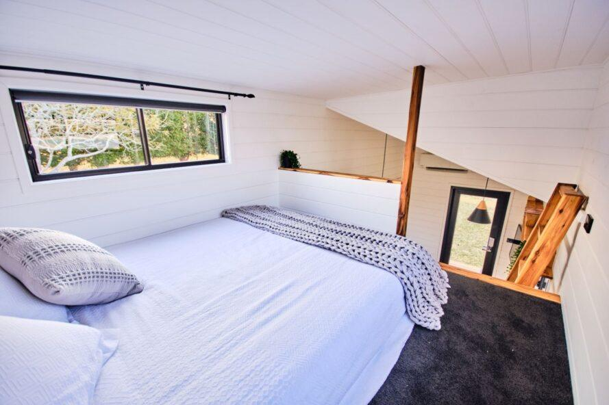 sleeping loft with queen-sized bed