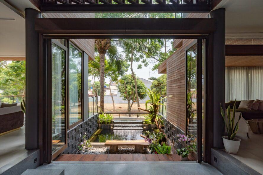 view of a green courtyard space from within the house