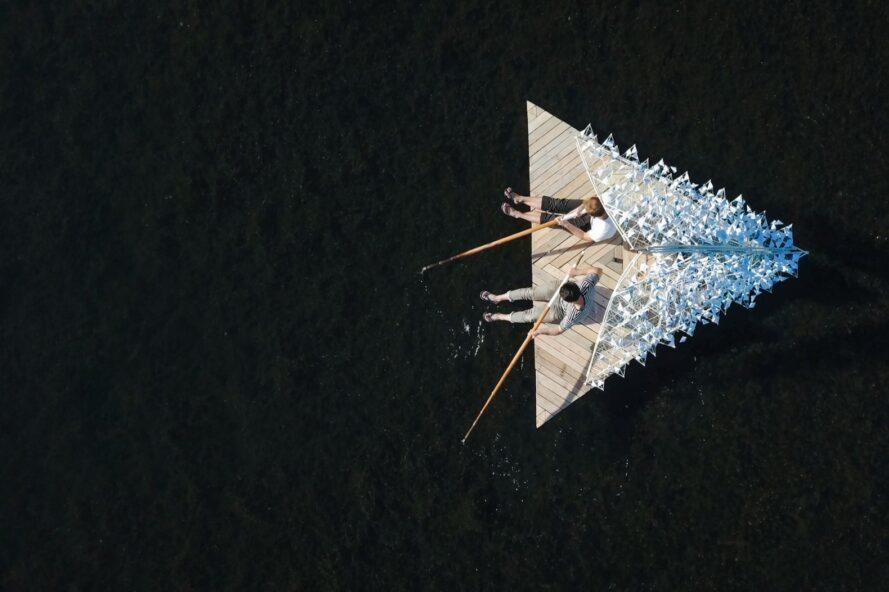 two people on a triangular raft