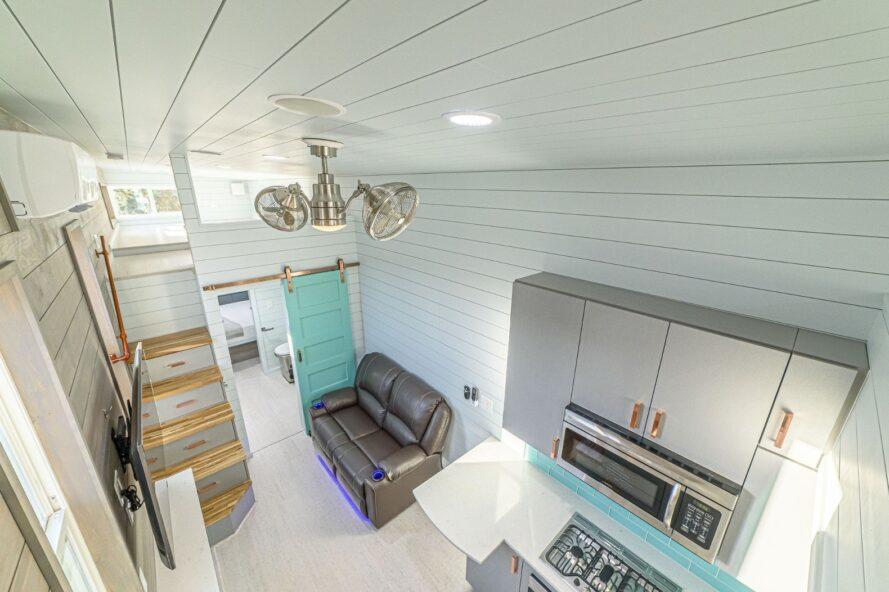 tiny home with white walls and aqua accents