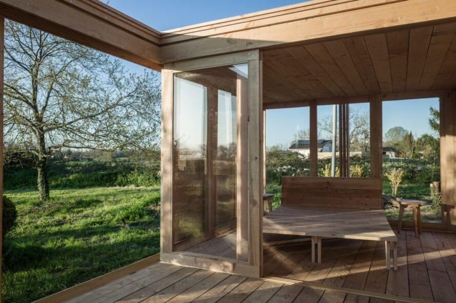 tiny wooden cabin with glass doors