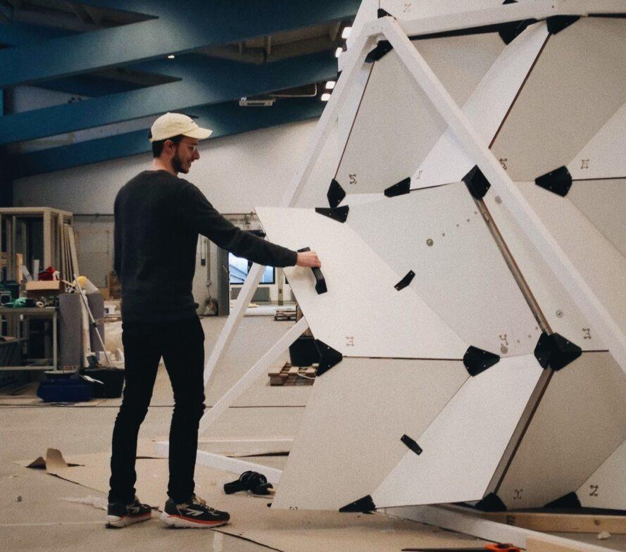 person building a pod with white panels