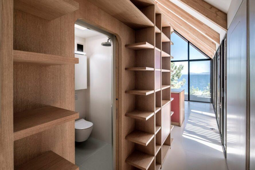 interior living space with natural wood bookshelves