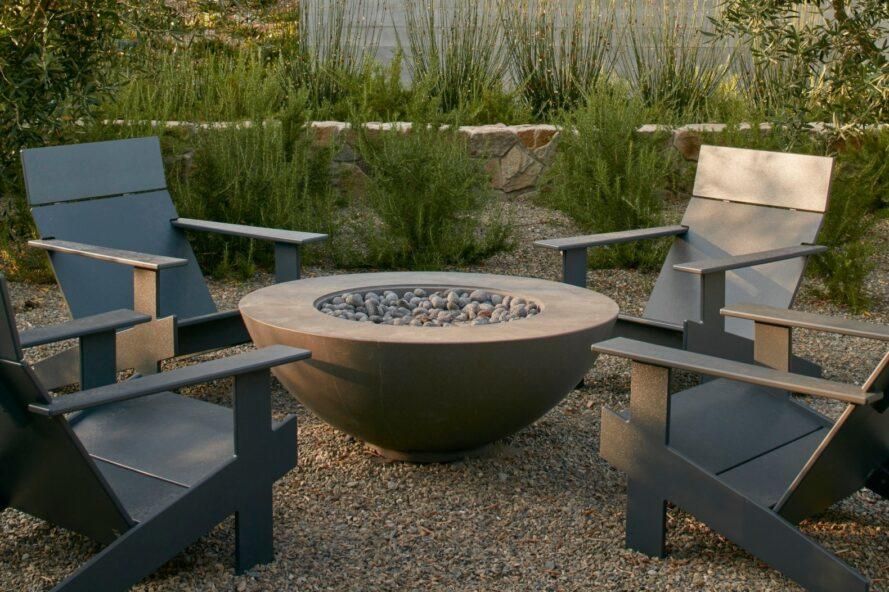 firepit surrounded by four chairs