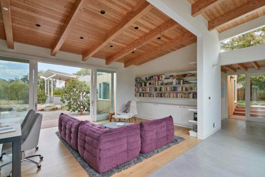 large living space with wooden ceiling and purple couch