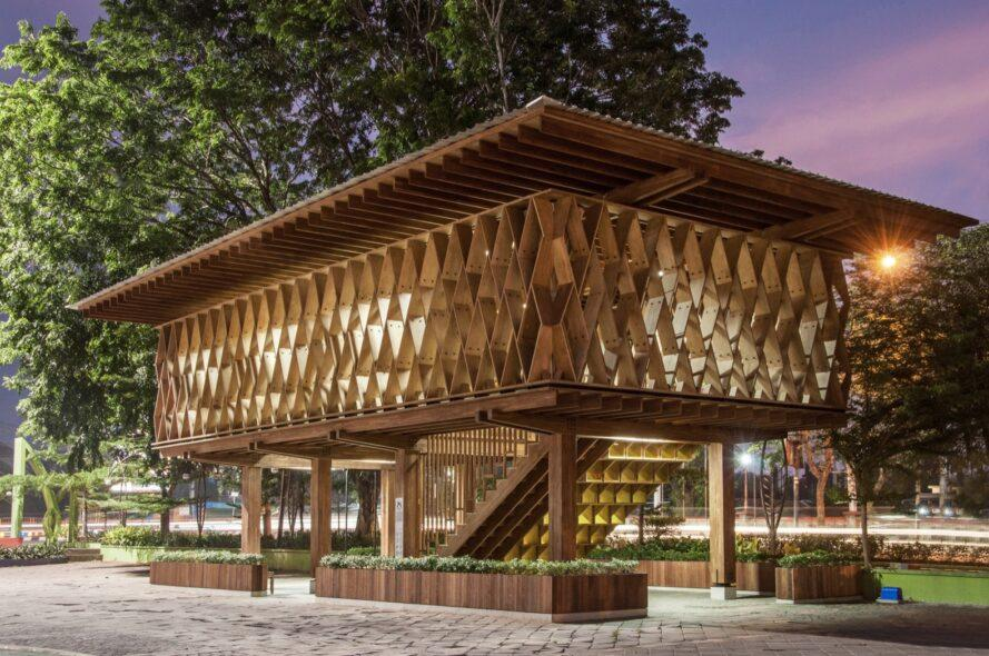 an elevated wooden library lit up in the evening