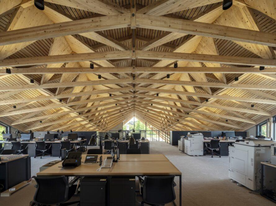 wood desks under a wooden ceiling