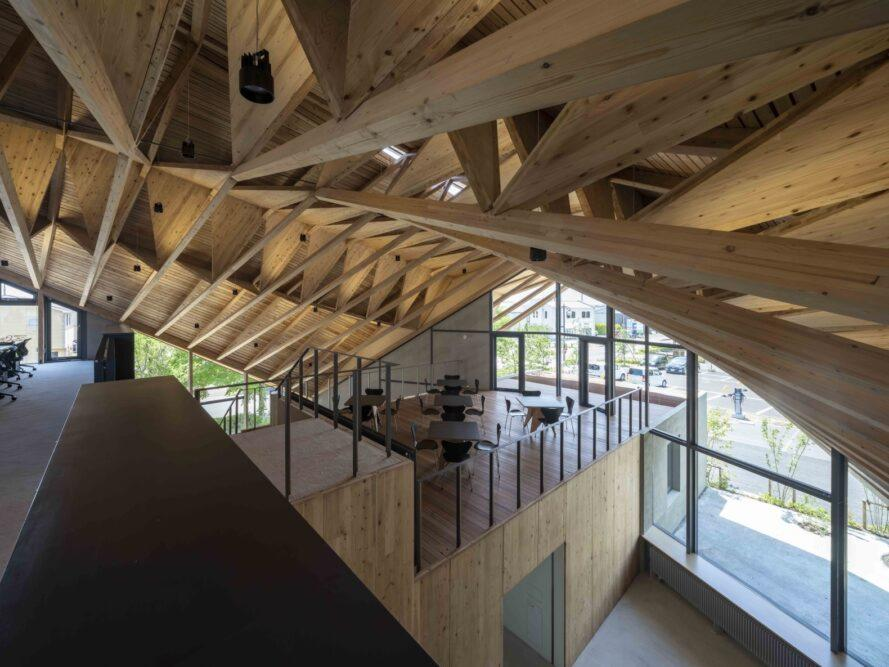 aerial view of first-floor office building and loft with exposed wood ceiling beams