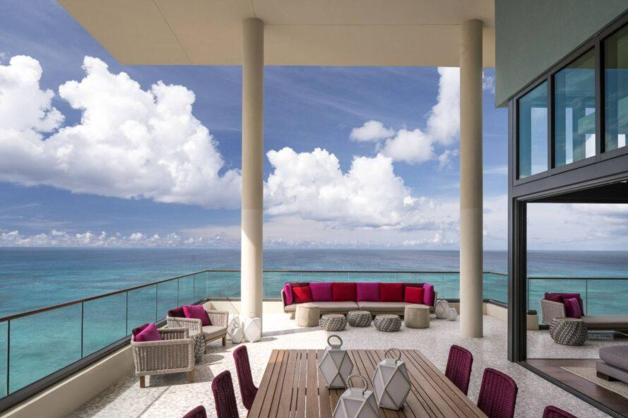 large luxurious balcony with ample red couches and chairs