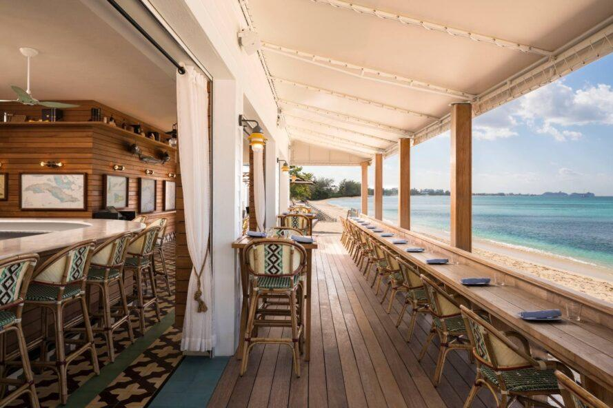 outdoor dining area with seating looking out over the sea