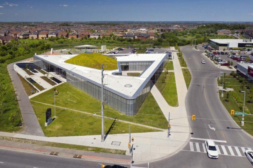 aerial view of triangle-shaped building with hilly green roof