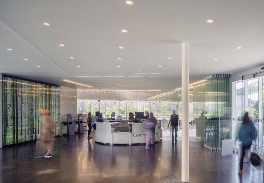 round reception desk in a glass building