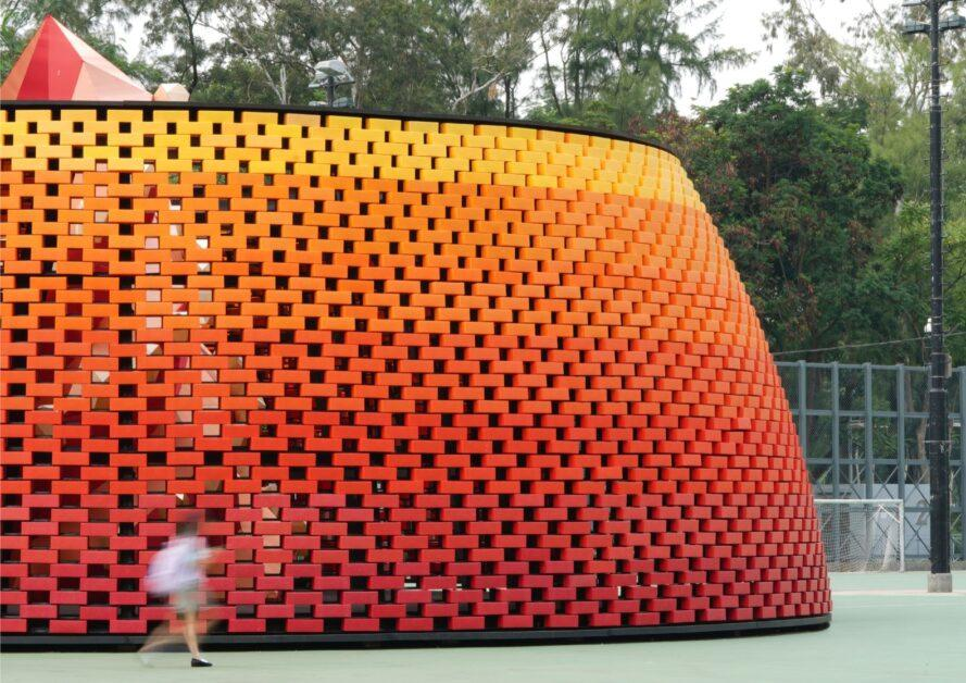 round pavilion with red, orange and yellow gradient exterior