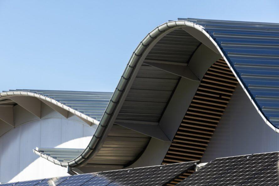 close-up of wavy roof covered in solar panels