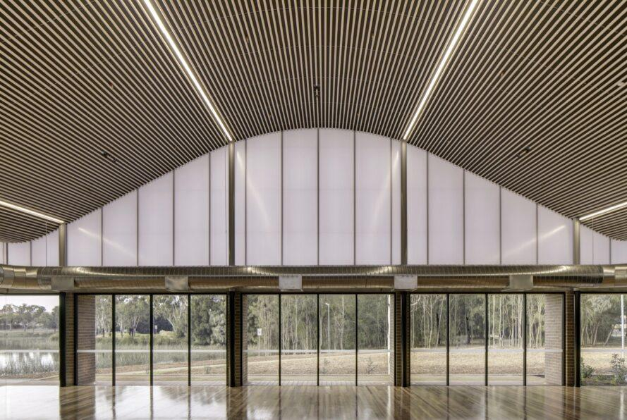 large open room with wavy ceiling and glass walls